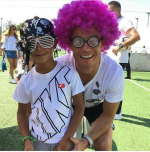 C. Ronaldo Rocks Pink Wig For Playful Snap With Son